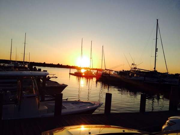 Sunset at the Harbor Marina contributes to the