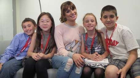 Singer and actress Lea Michele with Kidsday reporters