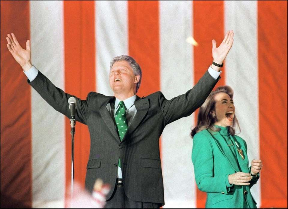 Bill Clinton celebrates his victory in the Illinois