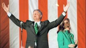 Bill Clinton celebrates his victory in the Illinois