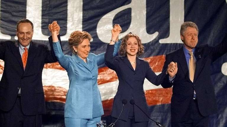 The Clintons and Sen. Chuck Schumer (D-N.Y.) celebrate