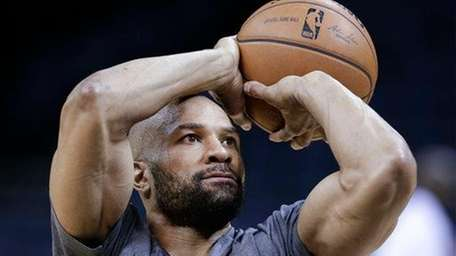 Oklahoma City Thunder guard Derek Fisher shoots during