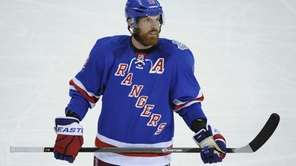 Rangers center Brad Richards looks on against the