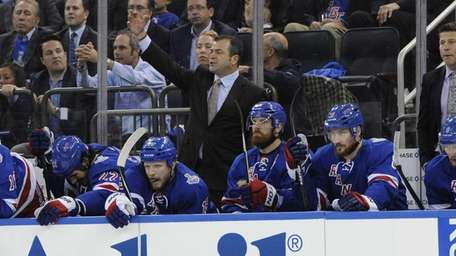 New York Rangers head coach Alain Vigneault reacts