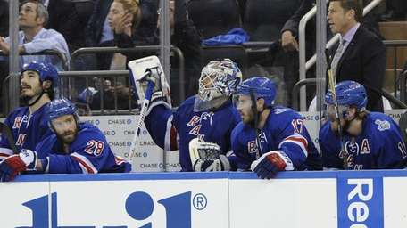Rangers' Henrik Lundqvist sits on the bench after
