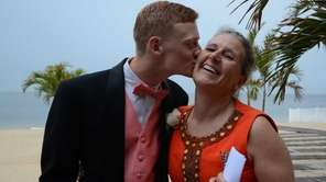 Michele O'Brien gets a kiss from son Patrick