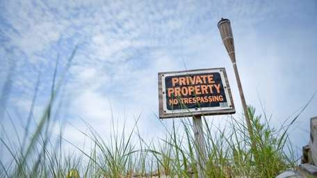 A sign indicating private property is posted at