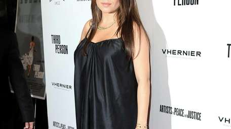 Actress Mila Kunis attends the premiere of Sony