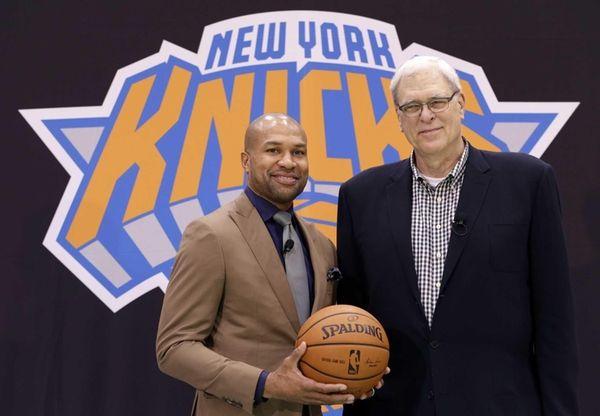 Knicks president Phil Jackson, right, poses with Derek