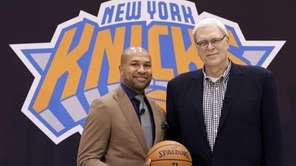Knicks president Phil Jackson, right, poses with Derek