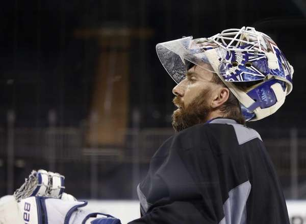 Rangers goalie Henrik Lundqvist pauses to rest during