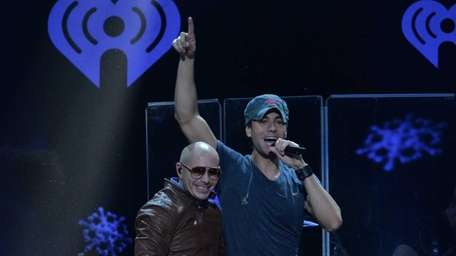 Pitbull, left, and Enrique Iglesias perform during Z100's