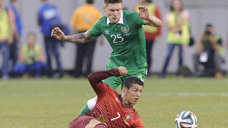 Portugal's Cristiano Ronaldo passes the ball as Republic