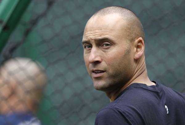 The Yankees' Derek Jeter watches batting practice on
