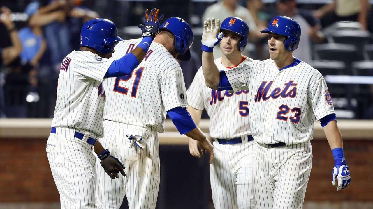 Taylor Teagarden of the Mets celebrates his sixth-inning