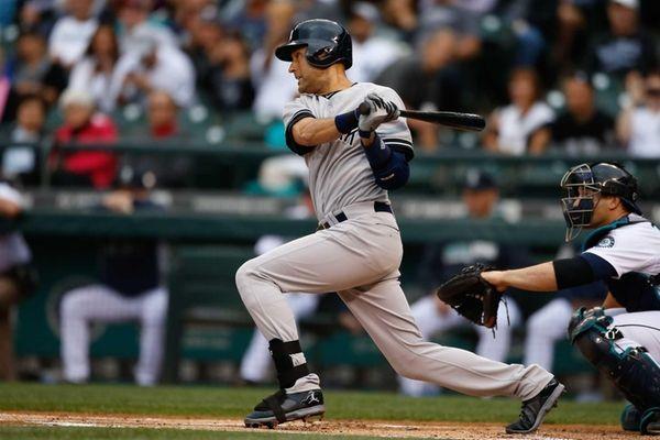Derek Jeter singles in the first inning against