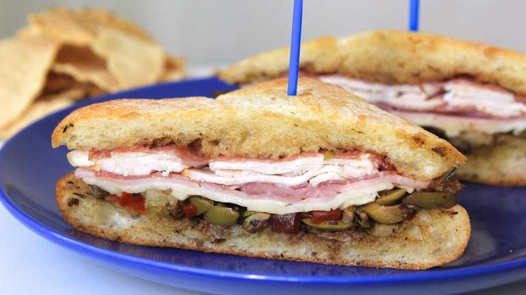 This dressing on this muffaletta-style sandwich is made
