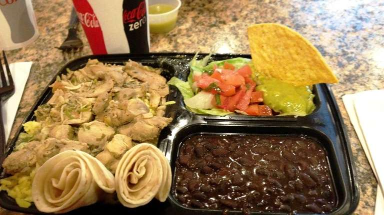 Chicken stew comes with rice, beans, tortillas and
