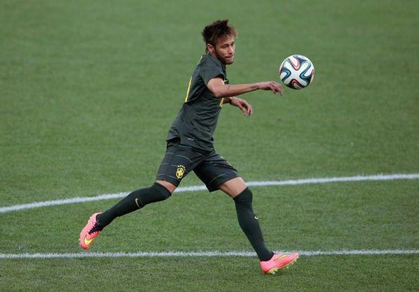 Neymar of Brazil kicks the ball during a