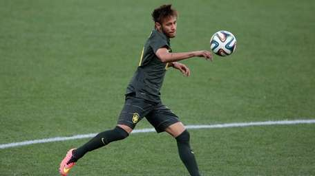 Neymar of Brazil kicks the ball during a