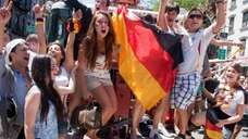 German soccer fans celebrate at Zum Schneider in
