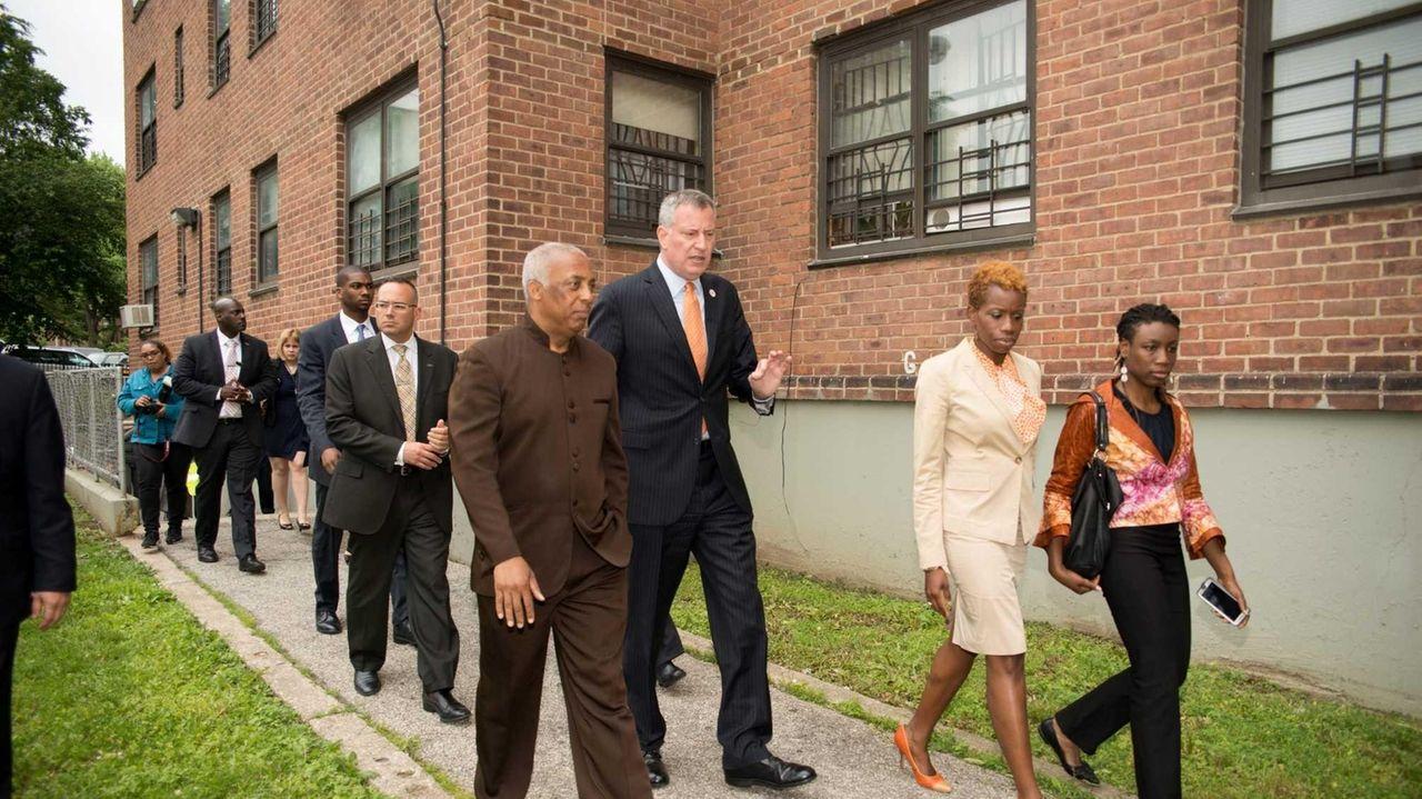 Mayor Bill de Blasio and other officials visit