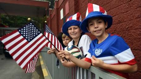 Young U.S. team fans wait to watch their