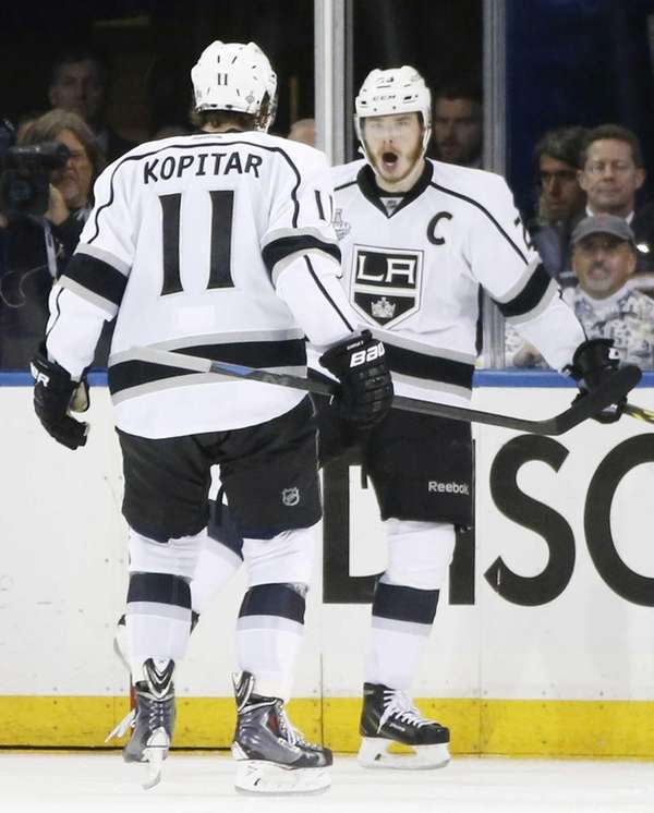 Los Angeles Kings right wing Dustin Brown reacts