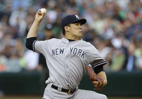 Yankees starting pitcher Masahiro Tanaka throws against the