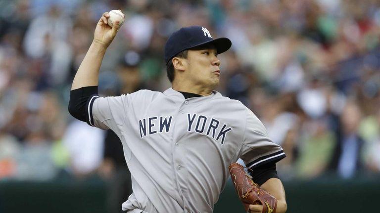 Yankees starting pitcher Masahiro Tanaka throws against the