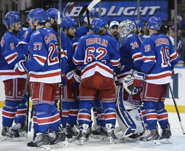 The Rangers celebrate their 2-1 win against the