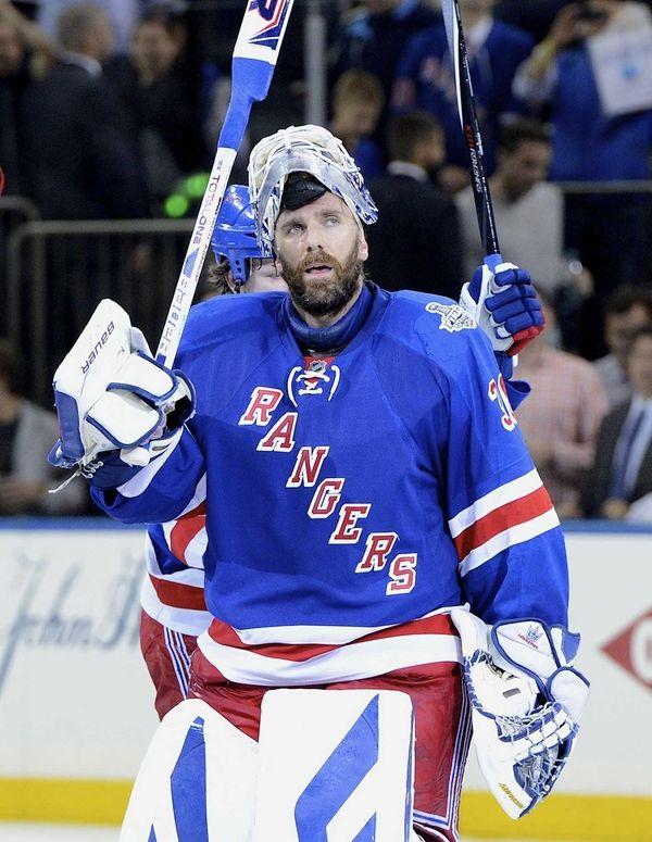 Rangers goalie Henrik Lundqvist raises his stick to