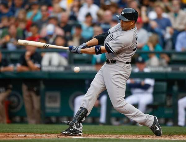 Carlos Beltran of the Yankees strikes out with