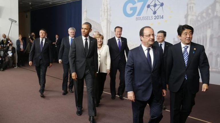 U.S. President Barack Obama, third left, walks with,