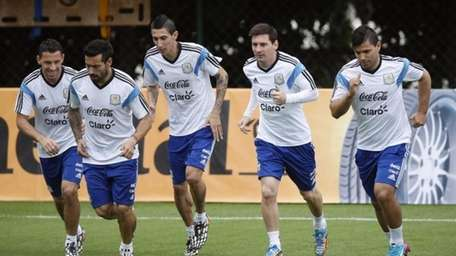 Argentine soccer players, from left, Maxi Rodriguez, Ezequiel