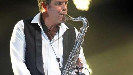 Musician Mark Rivera performs with Billy Joel at