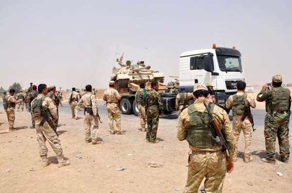 Kurdish security forces deploy outside of the oil-rich