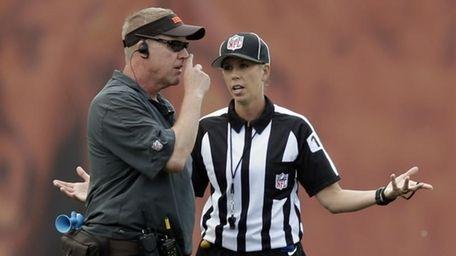 Referee trainee Sarah Thomas, right, talks to Cleveland