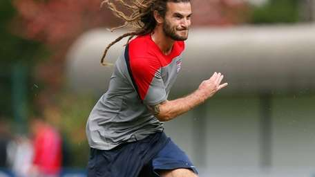Kyle Beckerman of the United States runs drills