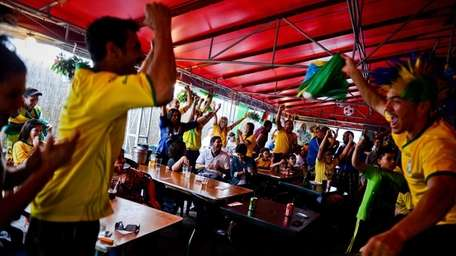 Fan celebrate a Brazilian goal while watching the