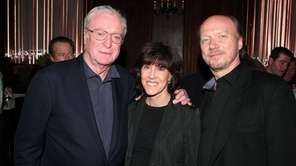Director Paul Haggis, right, with Michael Caine and