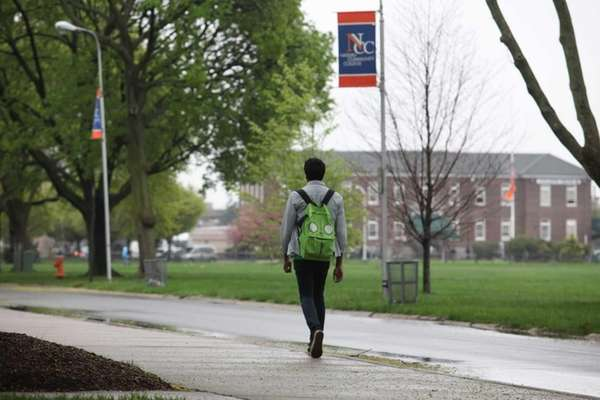 Students walk through the campus of Nassau Community