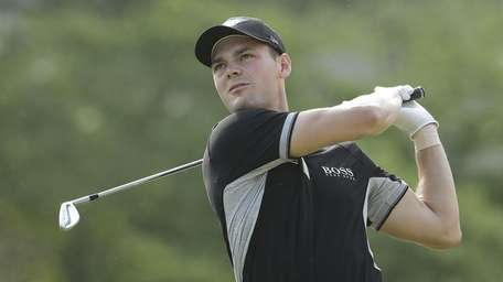 Martin Kaymer, of Germany, watches his tee shot