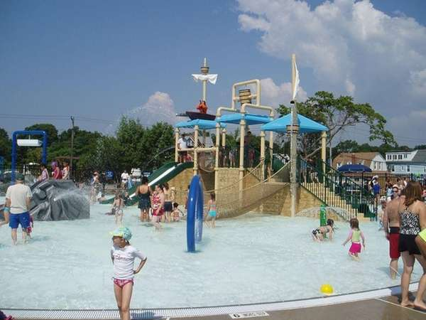 Matthew Bayes, 5, of Bay Shore, cools off