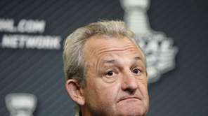 Los Angeles Kings head coach Darryl Sutter listens