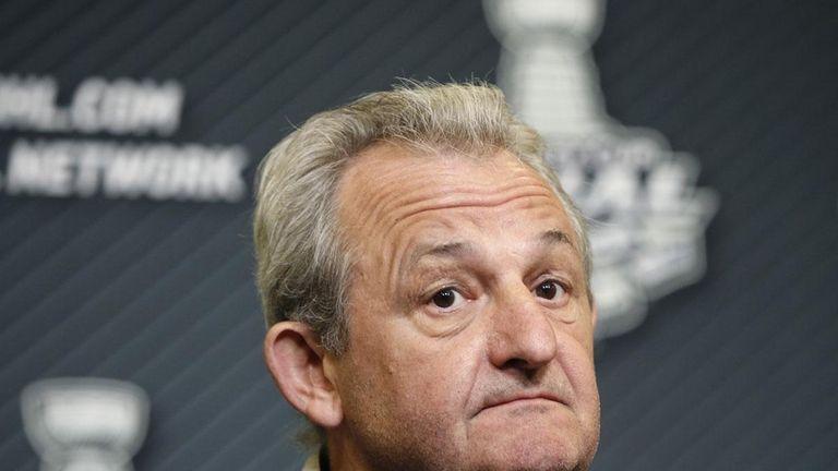 Los Angeles Kings head coach Darryl Sutter listens