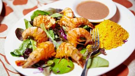 Camarones al grill is a dish of grilled