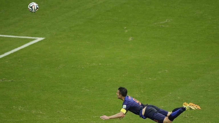 Netherlands' Robin van Persie heads the ball to
