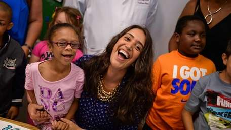Enza Grimaudo laughs with her second-grade student Melissa