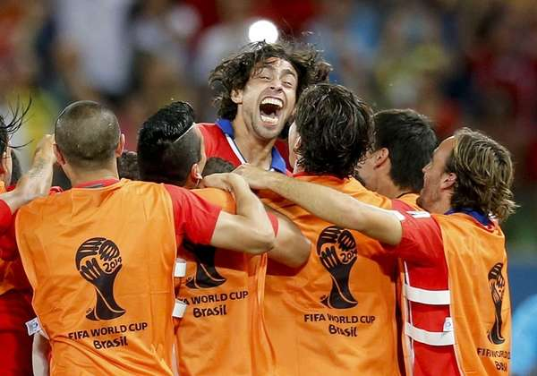 Chile's Jorge Valdivia, top center, celebrates after scoring